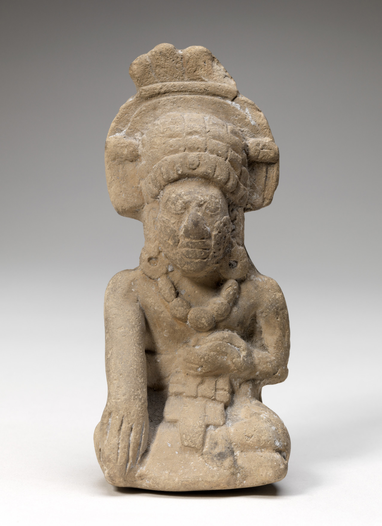 Unknown (Southern Campeche, Mayan, Mexican), Whistle figurine, Late Classic, 600-900CE. Mold-made terracotta, 5 1/16 x 2 5/16 x 2 5/8 in. Gift of Herbert D. N. Jones, Class of 1914. (21.1.3)