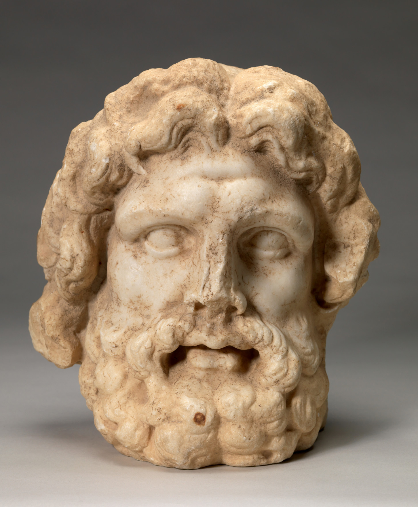 Greek or Roman, Head of a God, 150BC-100BCE. Parian marble, 11 7/8 x 11 1/8 x 7 1/4 in. Museum purchase, Greylock Foundation, Karl E. Weston Memorial Fund. (63.34)