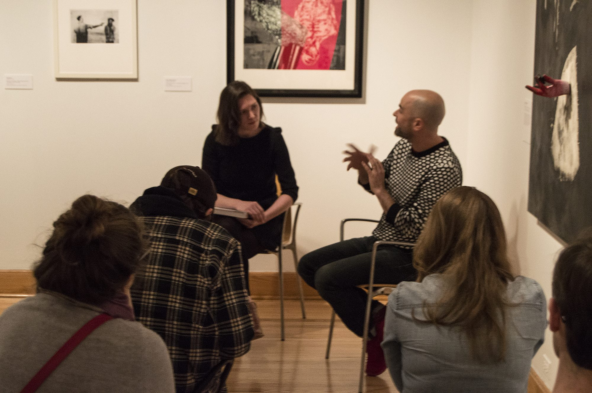 Anna Kelley MA '17 leads a gallery talk with artist Matthew Ronay in the exhibition she curated, State of Disobedience.