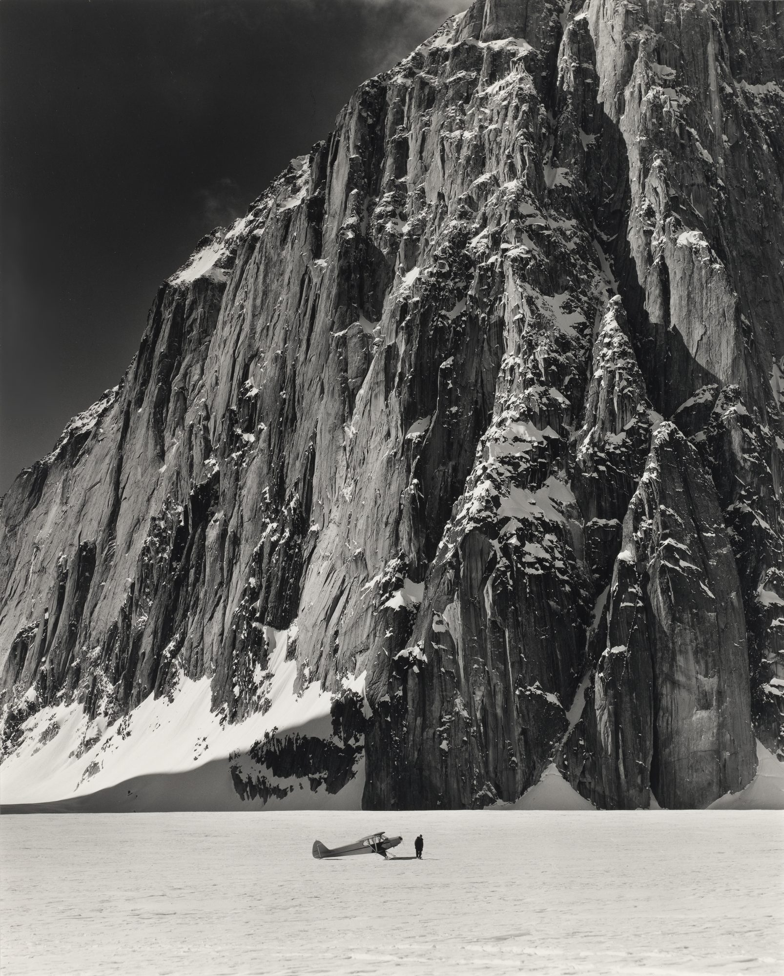 Bradford Washburn (American, 1910-2007) Don Sheldon with his Super Lab Plane in the Great Gorge of the Ruth Glacier at the foot of Mt. Dickey, Alaska