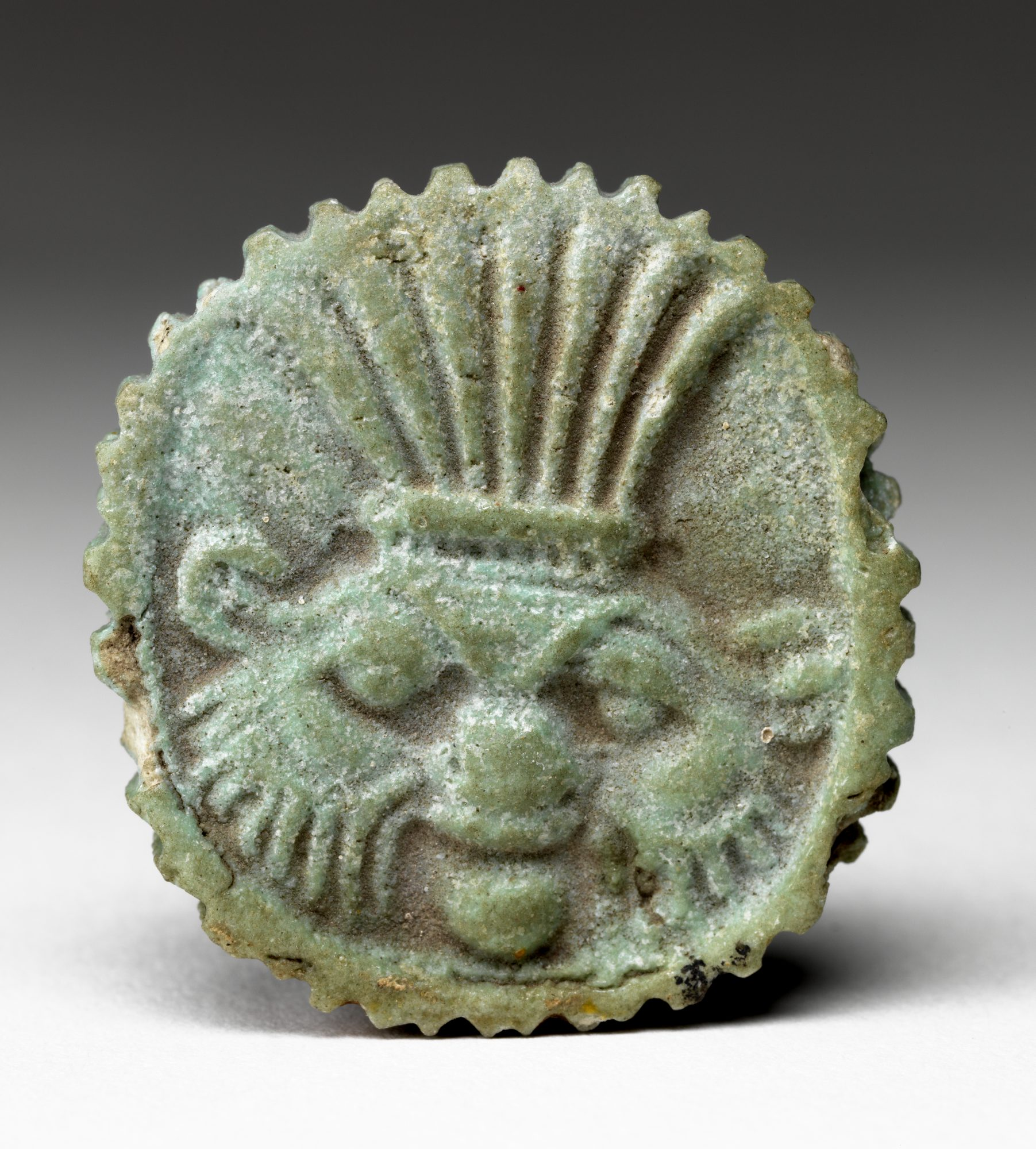 Unknown artist (Egyptian) Amulet of Deity with Headdress, Date unknown. Faience. Gift of Horace Mayer, 61.19.1.G