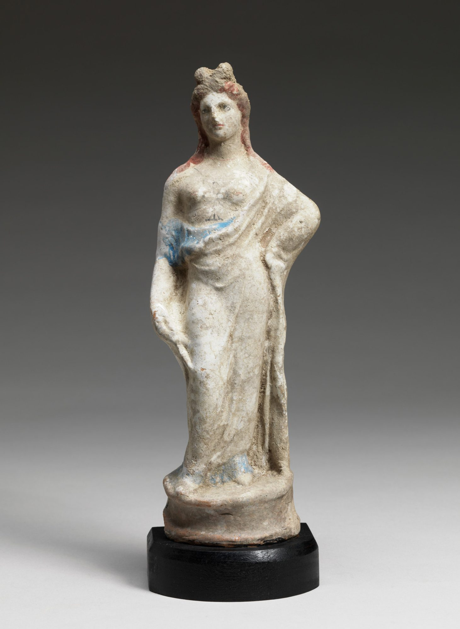 Greek, Standing Draped Woman, Possibly Aphrodite, 350-330 BC. Terracotta. Gift of the son and daughters of Charles Bolles Bolles-Rogers, Class of 1907: Frederick Van D. Rogers, Mary Rogers, Savage, and Nancy Rogers Pierson, 77.63.46