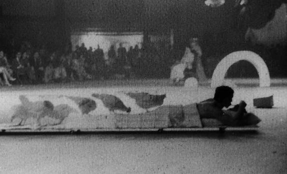 Steve Paxton in Rauschenberg's Linoleum (1966), NOW festival, April 1966. Photograph Collection. Robert Rauschenberg Foundation Archives, New York Photo: Steve Schapiro.
