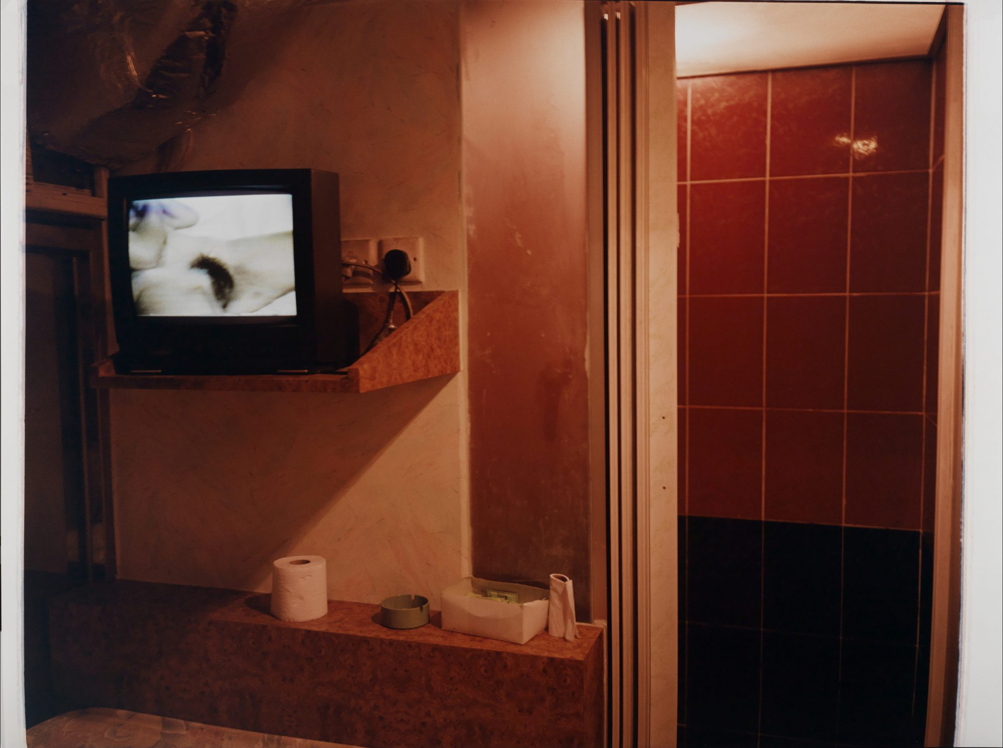 Reagan Louie (American, b. 1951) Room with TV. Hong Kong, 1997. Type C-print, Gift of the artist in honor of his son, Ralston Peregrine Louie, Class of 2014, M.2014.13.3