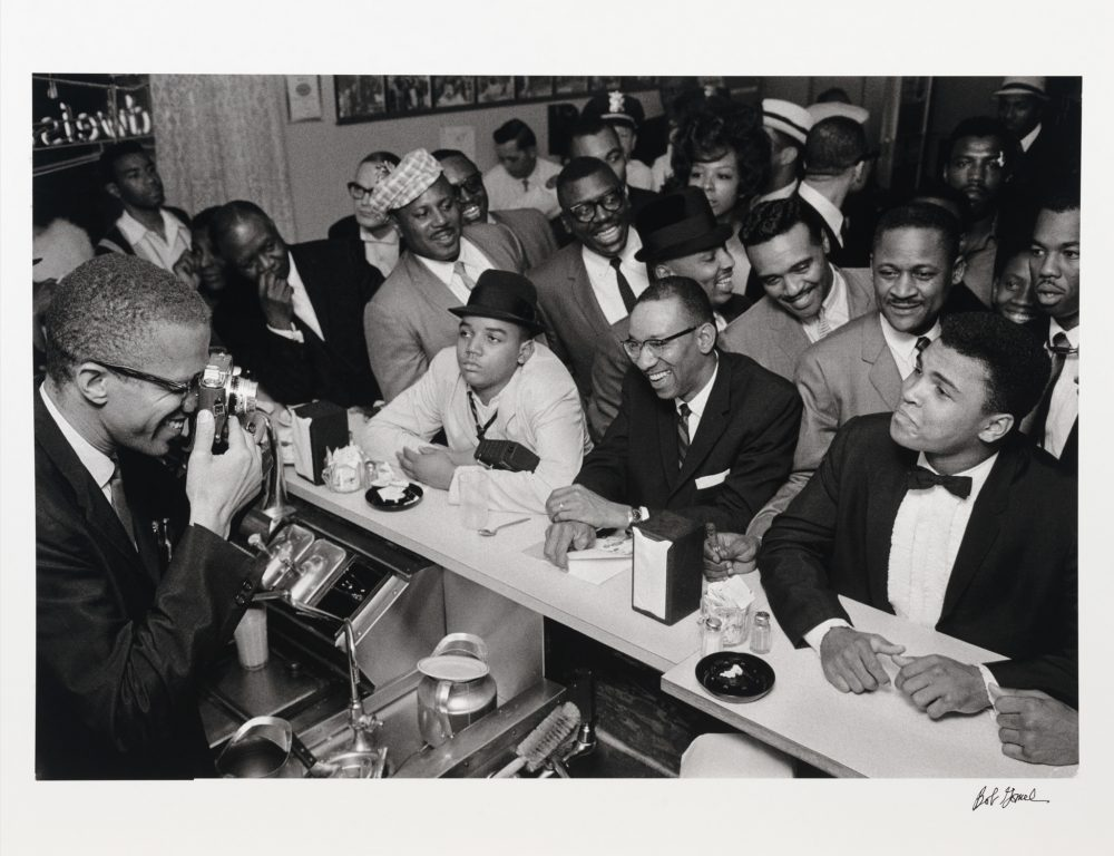 Bob Gomel (American, b. 1933), Malcolm X photographing Cassius Clay, Miami, 1964. Gelatin silver print, 17 x 22 in. Student Art Loan Program, Museum Purchase, Fulkerson Fund for Leadership in the Arts, SL.2013.9.3.