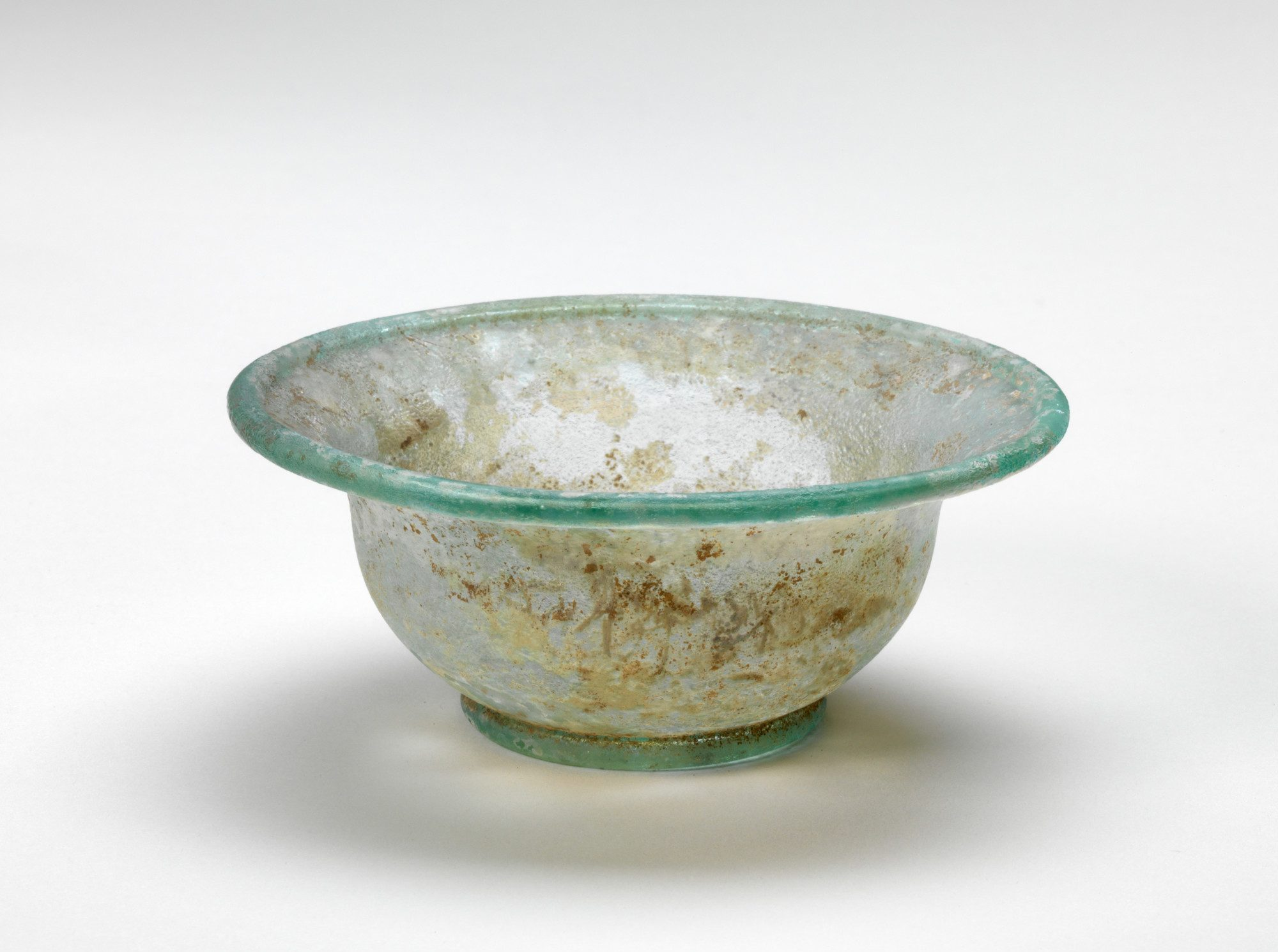 Syrian, wide-rimmed bowl, 1-299 AD. Free-blown glass, rim: 4 3/16 in. Gift of Mrs. Charles T. Cook, 30.1.16.