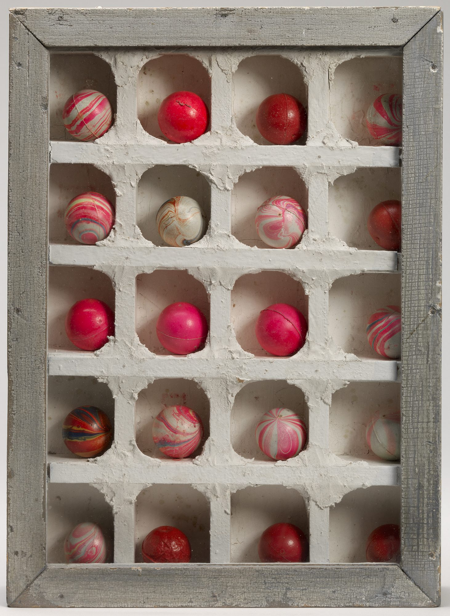 Joseph Cornell, (American, 1903-1972), Untitled, no date. Wood, glass, rubber balls and plaster, 14 13/16 x 11 x 2 5/16 in. Gift of Mrs. John A. Benton, 73.22.