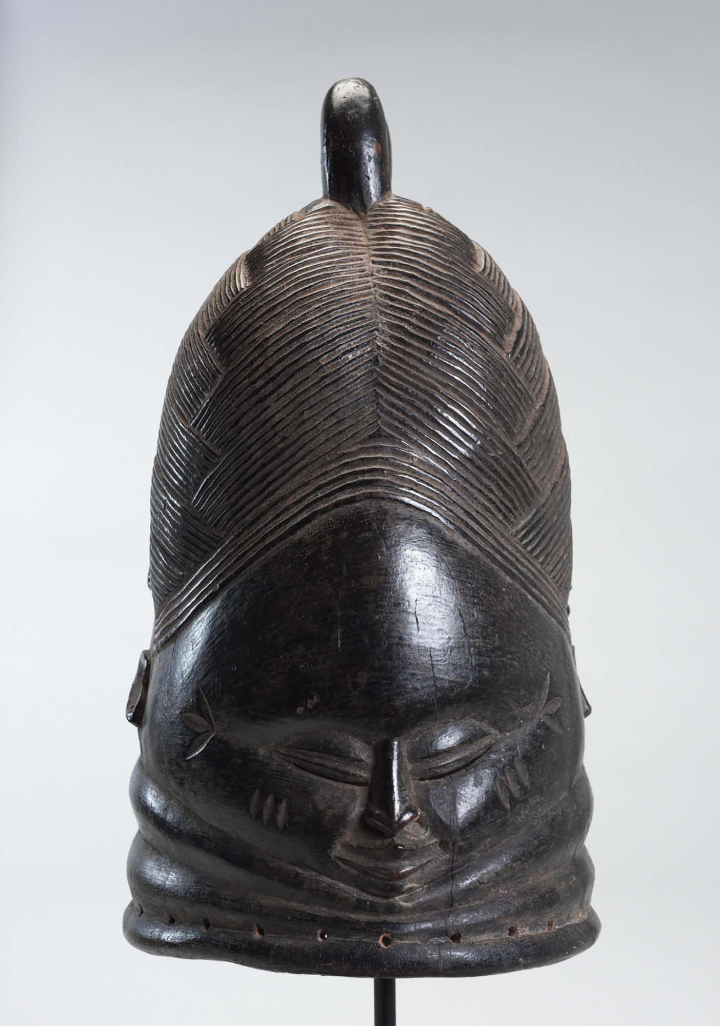 Unknown Arist (Mende People) Sande (Bondo) Society Mask, 20th century. Wood, 15 1/2 x 8 x 9 1/2 in. Gift of Dr. Oliver E. and Pamela F. Cobb, M.2005.16.3