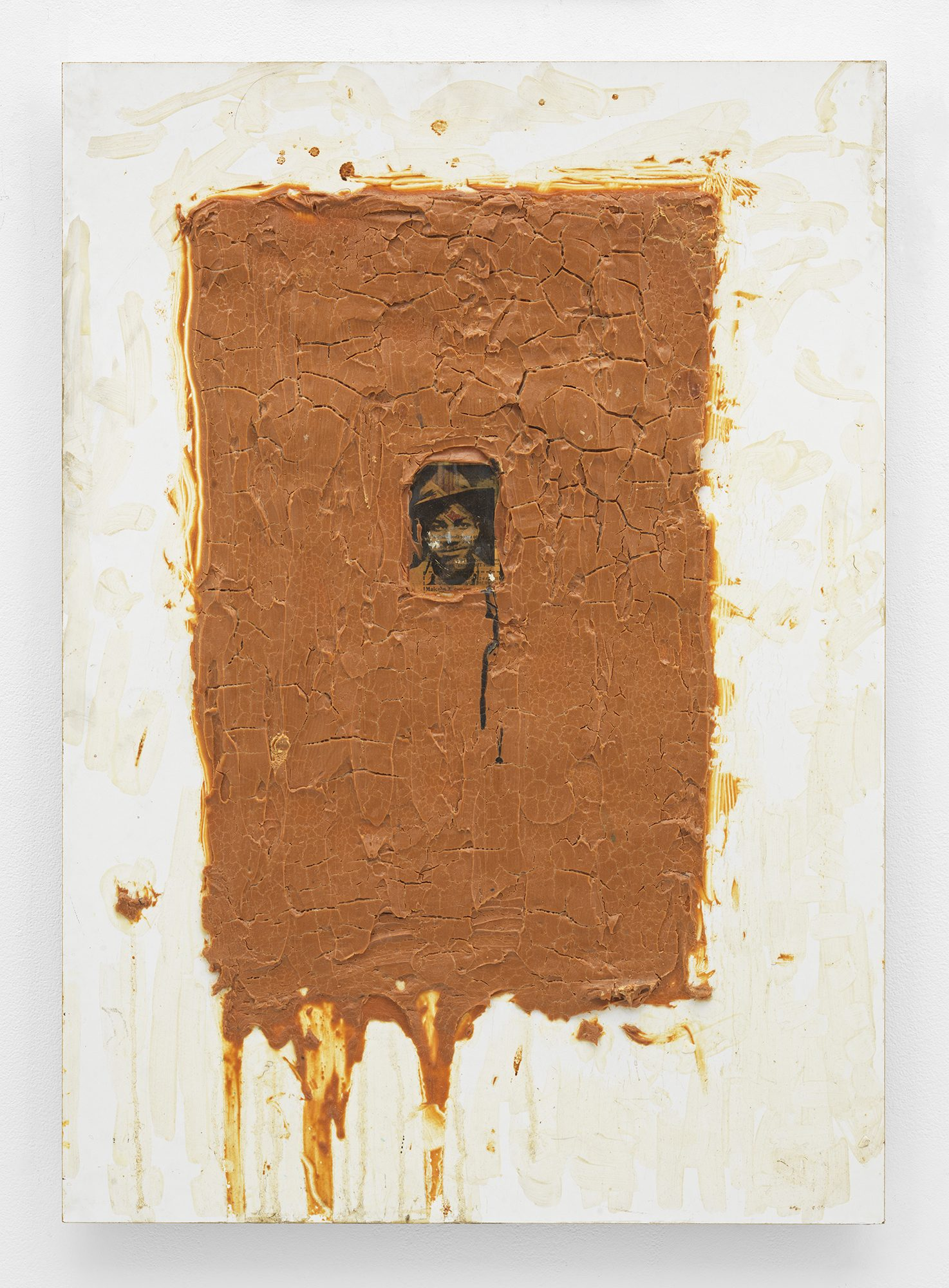 William Pope.L, Mal Content, 1992. Acrylic, gel medium, newspaper, and peanut butter on white formica on particle board . 34 7/8 by 24 3/4 by 2 in.