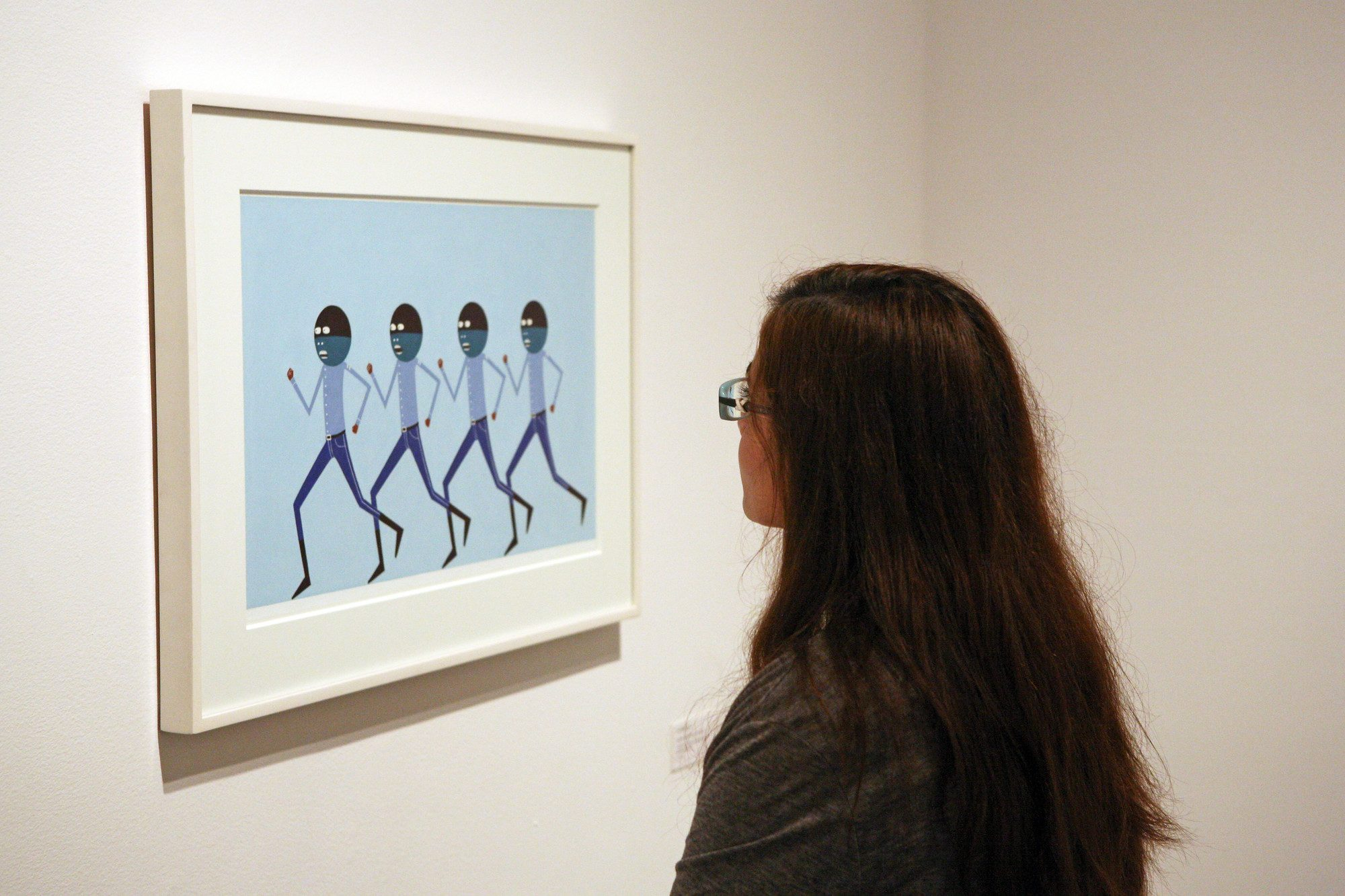 Installation view of Laylah Ali: The Greenheads Series with students from Exploring the Arts. Photo by Roman Iwasiwka.