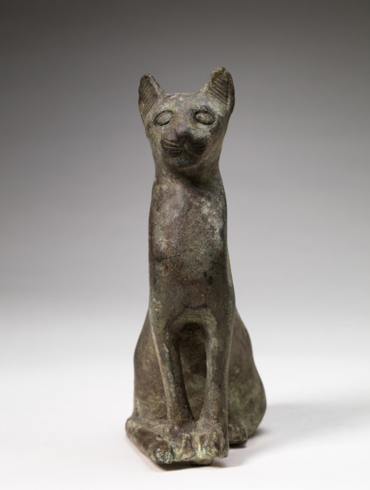 Egyptian Cat Sculpture, Greco-Roman Period (332 BC-32 AD), Bronze, Dims 5 3/16 x 1 15/16 x 3 5/16 in. (13.1 x 5 x 8.4 cm), Gift of the son and daughters of Charles Bolles-Rogers, Class of 1907: Frederick Van D. Rogers, Mary Rogers Savage, and Nancy Rogers Pierson 75.43.18