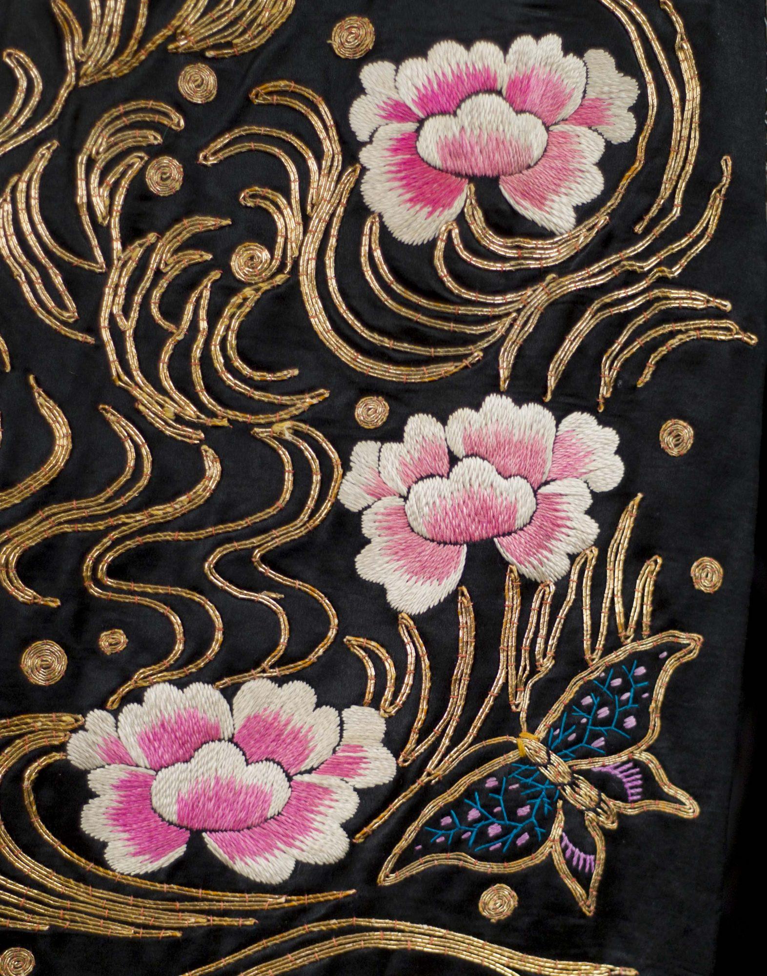 Obi, (detail), 1913. Silk satin embroidered with silk and metallic. Photo by David Dashiell.