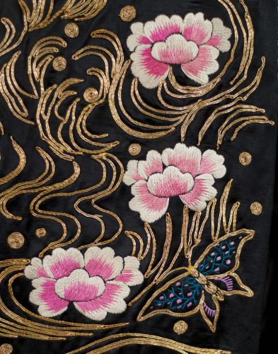 Obi, 1913. Silk satin embroidered with silk and metallic. Photo by David Dashiell. A detail of an obi worn by Ruth St. Denis in her 1913 Japanese work O-Mika. The silk satin obi is heavily decorated with silk and metallic embroidery.